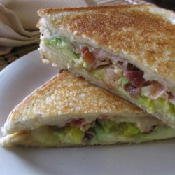 Bacon, Avocado, and Pepperjack Grilled Cheese Sandwich Recipe - Update the classic grilled cheese sandwich with bacon, red onion, and avocado pepperjack cheese for a buttery, savory treat.