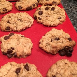 Vegan Chocolate Chip, Oatmeal, and Nut Cookies Recipe - This recipe delivers vegan-friendly peanut butter and oatmeal cookies with chocolate chips and walnuts.