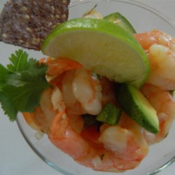 Spicy Mexican Shrimp Cocktail  Recipe - Cooked shrimp are chilled in a tomato-juice cocktail with avocado, red onion, and cilantro. The addition of habanero and jalapeno chiles brings the heat.