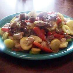 Garden Chicken Stir Fry Recipe - Fresh yellow summer squash, deep green zucchini and a variety of vegetables pack so much flavor and color into this simple stir fry.  Lightly sauteed pecans make it just a little different.
