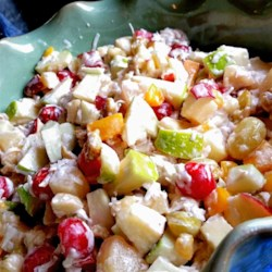 Mami Elva's Fruit Salad Recipe -  Crunchy, fruity and sweet. That about sums up this nifty fruit salad, and it is so easy to make. Fruit cocktail and pears are stirred into a bowl full of cherries, fresh apples, bananas, walnuts and coconut. Then a jar of marshmallow cream is folded in. Makes eight generous servings.