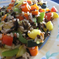 Wild Rice Casserole Recipe - A hearty casserole that's easy to prepare. Bake brown and wild rice with your favorite vegetables; this recipe calls for red and green bell pepper, zucchini, carrot and celery.