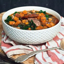 Smokey Sausage, Kale & Sweet Potato Soup Recipe - This soup is so versatile that it works with whatever you have on hand. Use cannellini, black or kidney beans if you prefer them to chickpeas--or take them out altogether. Use spinach instead of kale. Adjust the spices if you prefer something a bit tamer.