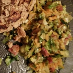 Brussels Sprout Hash Recipe - Honey-flavored butter and cooking wine are the secrets to tasty sauteed Brussels sprouts made quickly.