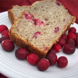 Banana Cranberry Bread Recipe - Cranberry sauce and bananas are blended deliciously in this easy, moist holiday bread.