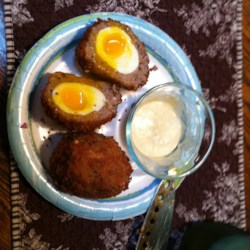 Chef John's Scotch Eggs Recipe - Chef John's version of Scotch eggs calls for soft-boiled eggs; when you bite into the egg you get an amazing contrast between molten yolk and crispy sausage shell. A fantastic Easter treat!