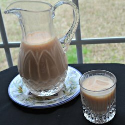 Agua de Melon (Cantaloupe Juice) Recipe - This simple beverage of cantaloupe blended with water and sweetened condensed milk is a great, refreshing option for summertime.