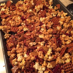 DB's Caramel Popcorn Bacon Mix Recipe - Caramel corn gets a salty twist with the addition of maple-coated bacon and pretzels creating a sweet and savory snack everyone will love.
