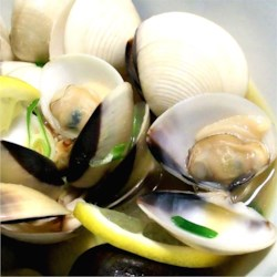 Steamed Clams in Butter and Sake Recipe - This recipe is the best for seafood lovers. Clams are steamed with sake and mirin and a bit of green onion in this Japanese-style preparation.