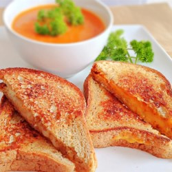 Grilled Cheese Sandwich Recipe - Bread, butter and Cheddar cheese - here's a way to make this classic sandwich in a nonstick pan.