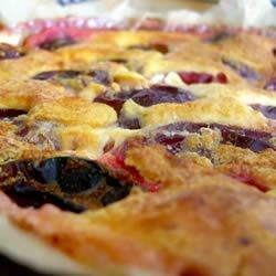 Plum Clafouti Recipe - A family favourite that fills the house with a cinnamon aroma.  A delicious plum dessert, dusted with icing sugar!