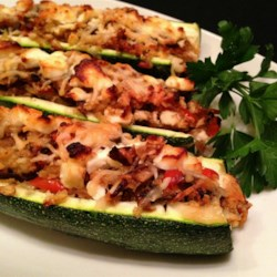 Stuffed Zucchini Shells Recipe - You'll need to hollow-out zucchini halves so you can fill them with the zucchini cooked with mushroom, onion, and garlic for a side dish that makes a great impression at the dinner table.