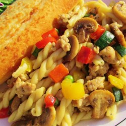 Stoplight Sausage Pasta Recipe - Whole wheat pasta with turkey sausage and red, green, and yellow bell peppers is a quick meal to prepare on the stove top.