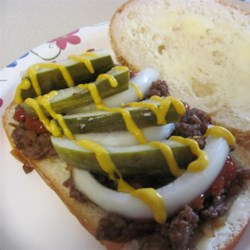Iowa Maid-Rites Recipe - Onion flavored ground beef with broth is served on hamburger buns in this Iowa classic sandwich. I came up with my own version of Iowa MaidRites which also are called 'loose meat' sandwiches. Very versatile, leftover beef can be used for spaghetti or taco filling, or it can be frozen for later use.