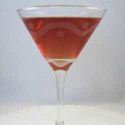 The Duchess Martini Recipe - Anyone will feel like a duchess while drinking this martini made with champagne, orange-flavored liqueur, and raspberry-flavored liqueur.