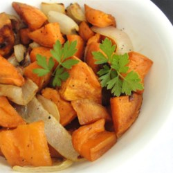 Oven Roasted Sweet Potatoes Recipe - This is a simple side dish recipe for sweet potatoes roasted with sweet onion and garlic and finished with a drizzle of balsamic vinegar.