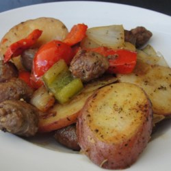 Sausage, Peppers, Onions, and Potato Bake Recipe and Video - A hearty old-style Italian dish, New York City style, has browned chunks of sausage, potatoes, red and green peppers, and onions baking together with wine and seasonings.