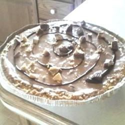 Peanut Butter Pie XVIII Recipe - Melted candy bars and peanut butter in a fluffy frozen no-bake pie.