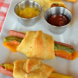 Easy Cheesy Hot Dog Crescent Rolls Recipe - Hot dogs are wrapped in cheesy crescent roll dough and baked into a perfect snack or treat for birthday parties.