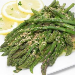 Crunchy Sesame Lemon Asparagus Recipe - Toasted sesame seeds, lemon juice, and parsley are added to melted butter and drizzled over crisp asparagus in this quick and easy lemon asparagus recipe.