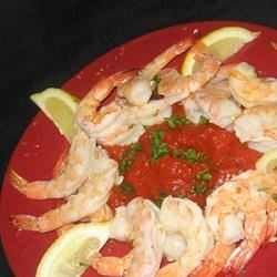 Prawns of Passion Recipe - It's all about garlic.  Prawns broiled in garlic butter and served over a garlic tomato sauce.