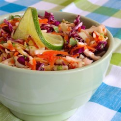 Tri-Color Slaw with Lime Dressing Recipe - This recipe makes a great cabbage slaw in a fresh lime dressing to pair with Southwestern dishes.