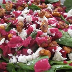 Spinach and Goat Cheese Salad with Beetroot Vinaigrette Recipe - A beet vinaigrette is drizzled over baby spinach leaves and walnuts coated with caramelized sugar. Goat cheese brings a final element of distinction to this elegant salad.