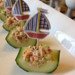 Tuna and Veggie Cucumber Boats Recipe - Tuna salad with carrot, celery, onion, and broccoli is served in cucumber 'boats' in this simple recipe.