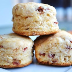 Cinnamon Biscuits Recipe - Two types of baking mix, reduced-fat and whole wheat, are used in this buttermilk biscuit shaped like a cinnamon roll. Cinnamon chips are rolled into the biscuit dough, and sprinkled on top.
