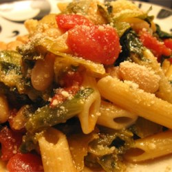 Penne Pasta with Cannellini Beans and Escarole Recipe - This is a great pasta dish. The hardest part of the whole recipe is cutting the escarole. It is fast, simple, and delicious! What more could you ask for? With a loaf of Italian bread it goes a long way. Enjoy!