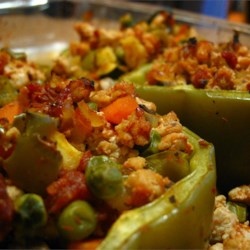 Stuffed Peppers with Turkey and Vegetables Recipe - Turkey and a variety of vegetables make a great filling for stuffed green bell peppers.