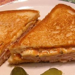 Grilled Hot Turkey Sandwiches Recipe - These grilled turkey sandwiches get a spicy kick from pepperjack cheese, zippy salsa, and bright green onions.