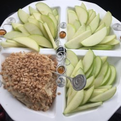 Apple Brickle Dip Recipe - Toffee bits are stirred into a sweetened cream cheese to make a yummy dip for apples. It's a perfect dessert to pack for lunch, or for an afternoon snack.