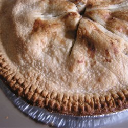 Fresh Pear Pie Recipe - Sliced pears are tossed with a lemon-cinnamon sugar mixture and baked in a double-crust pie shell. Serve plain, or topped with whipped cream or ice cream.