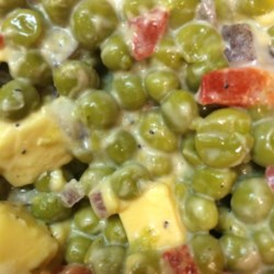 Pea Salad With Pimentos and Cheese Recipe - Canned sweet peas, Colby cheese, pimentos, and creamy mayonnaise combine for a tasty, easy salad that's best when chilled overnight.