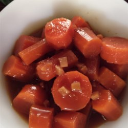 Slow Cooker Chinese Carrots Recipe - Baby carrots are slow cooked until meltingly tender in a sweet and savory Asian inspired sauce with orange, ginger, and sesame oil.