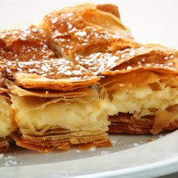 Tiropita Recipe - This Greek cheese pie is made with layers of crispy phyllo dough and a filling of feta and Kefalotiri cheeses. If you can't find Kefalotiri, you can use Parmesan cheese.