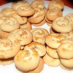 Koulourakia II Recipe - This Greek recipe makes 's'-shaped, cinnamon-flavored cookies sprinkled with sesame seeds.