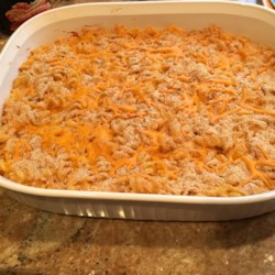 Easy Baked Mac-N-Cheese Recipe - Alfredo sauce and Cheddar cheese are baked with rotini pasta for a warm and comforting meal any day of the week.