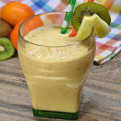 Crunchy Pineapple Smoothie Recipe - Pineapple, oranges, and kiwi fruit are blended with green tea and Greek yogurt creating a creamy and fruit-filled smoothie for an on-the-go breakfast.