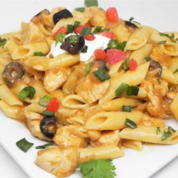 Chicken Enchilada Pasta Recipe - Give your Mexican night a twist by cooking up this recipe for chicken enchilada pasta that will have you going back for seconds and thirds!