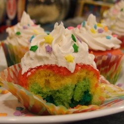 Rainbow Cupcakes Recipe - Vanilla cake batter is colored with food coloring and layered to make rainbow cupcakes that will delight kids of all ages!