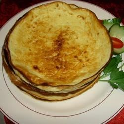 Russian Pancakes - Blini Recipe - Thin layered blini with melted butter.. a true Royal Russian breakfast! Best eaten with sour cream, jams and honey.