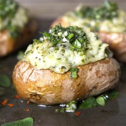 Chimichurri Twice-Baked Potatoes Recipe - These Chimichurri Twice-Baked Potatoes are courtesy of Heather Christo as part of the U.S. Potato Board's Potato Lovers Club. Fresh parsley, oregano, garlic and olive oil make up this Argentinean-inspired sauce that is whipped into baked potatoes.