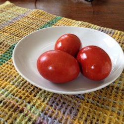Greek Easter Eggs Recipe - Hard-boiled eggs are simmered in a natural red dye made from onion skins in this recipe for Greek Easter eggs.