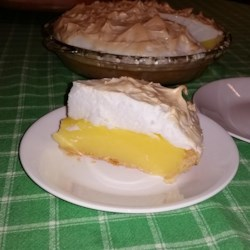 Lemon Meringue Pie III Recipe - First you make real lemon custard studded with bits of lemon zest. Then you whip up the meringue. Half the meringue gets folded into the filling, and the other half gets spooned on top of the pie.