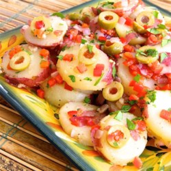 Savory Spanish Potato Salad Recipe - This Spanish-style potato salad includes potatoes, red bell pepper, and olives tossed in an olive oil-based dressing that goes well with many main dishes.