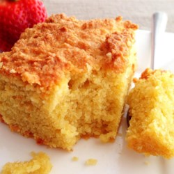 Gluten-Free Orange Almond Cake with Orange Sauce Recipe - A moist and light orange flavored gluten-free cake that can be served alone with light yogurt for afternoon tea, or add the orange sauce for a decadent dessert!