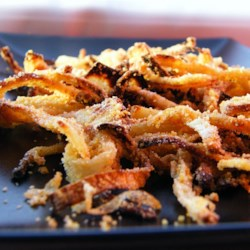 Gluten-Free Onion Topping Recipe - This is a tasty, gluten-free recipe for oven-fried crispy onion topping; use them to top green bean casserole or on a hamburger for a bit of crunch!