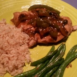 Chicken Pepper Steak Recipe - Chicken breast simmered with onion, bell pepper, tomatoes, soy sauce, and spices to be served with a rich pepper steak style gravy. If you like the taste of pepper steak but really don't enjoy red meat, try it with chicken!
